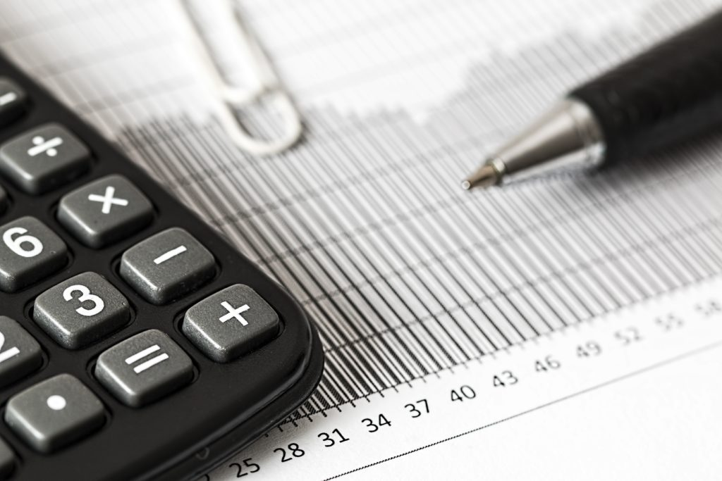 calculator, pen, and document