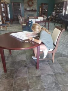 child working at a table