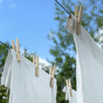 Sheets hanging on a clothesline outside