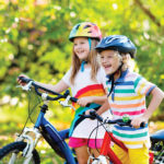 two kids riding bikes