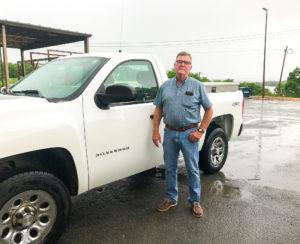 Richard Ballard by truck outside